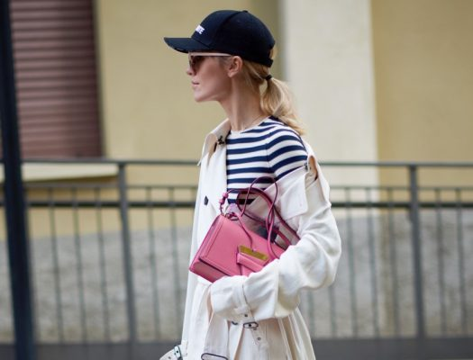Perfect for wet weather and right on trend, wear a cool baseball cap over a messy ponytail for off-duty chic.
