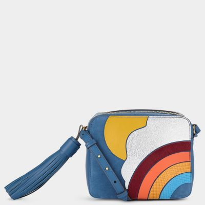 Animated prints add a jovial touch to your look without compromising on sophistication.ANYA HINDMARCH
