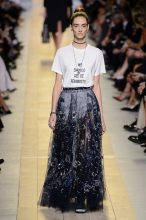 Christian Dior. While the T-shirt itself may have reached its zenith, the combination of the cotton top and bejewelled skirt is one that continually inspires. Look to the reflective matte beading of embroidered lightweight skirts and pair with your favourite slogan tee or crisp cotton dress shirt.