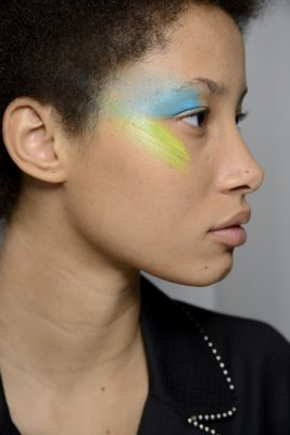 Try Max Mara's colour-blocking effect at your next music festival, adding an artisanal touch to makeup-free skin.