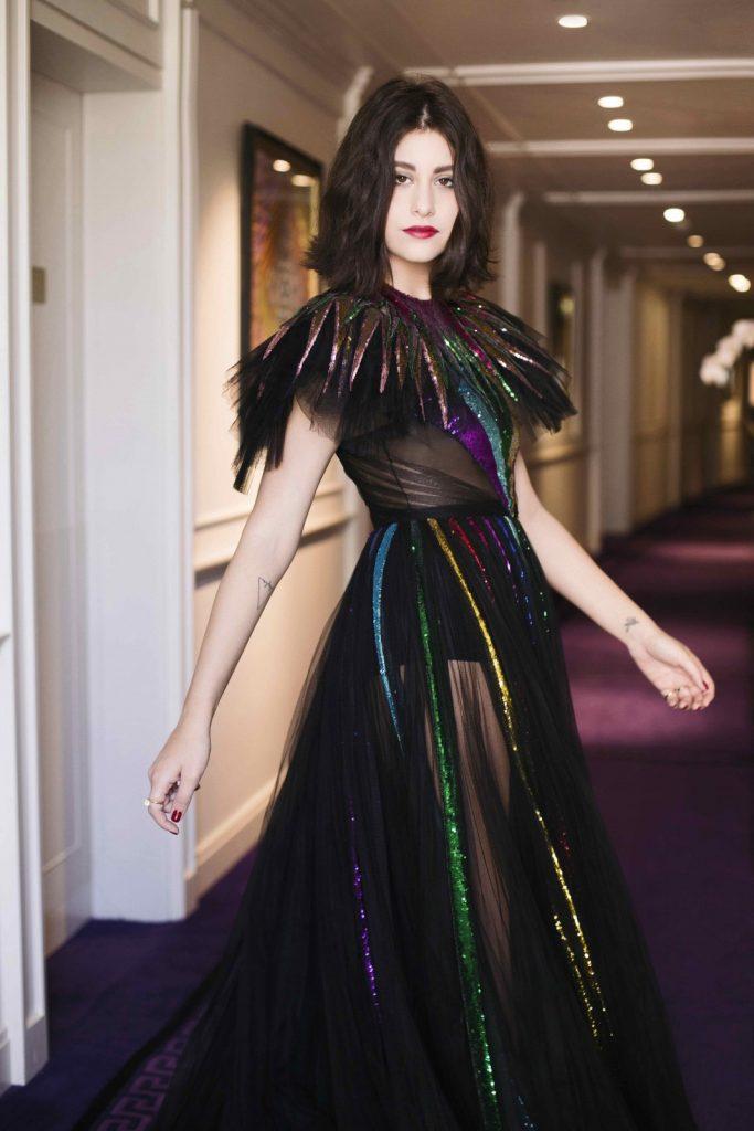 Nour wears Gucci dress