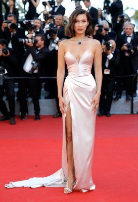 Bella Hadid | Alexandre Vauthier's Haute Couture special bustier silk gown adorned the 20-year-old model. The pale pink creation featured a super thigh-high slit, and was worn with a eye-popping sapphire and white-diamond choker necklace.