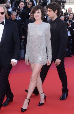 Charlotte Gainsbourg | Daughter of fashion icon Jane Birkin, this French-British actress-turned-singer looked cute as well as sexy in a long-sleeved, ultra-short Saint Laurent mini-dress designed by Anthony Vaccarello.