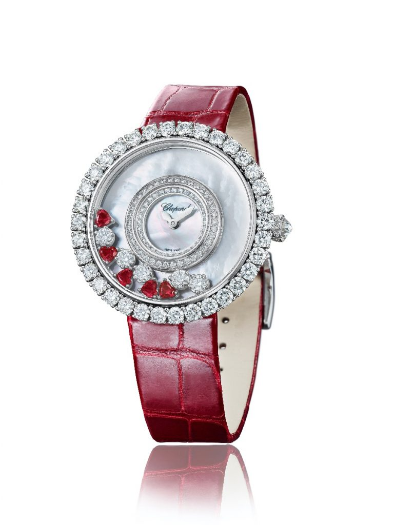 Framed by an 18-carat white gold case, the mother-of-pearl dial of Chopard's Happy Diamonds Joaillerie model