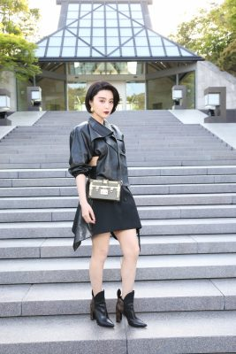 Chinese superstar Fan Bingbing embraced a rock chic aesthetic opting for a deconstructed black leather dress and ankle boots.