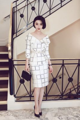 Fan Bingbing | The Chinese actress and pop singer looked exceptionally sophisticated in a monochrome graphic silk zibeline tailleur by Ralph&Russo, which featured an off-the-shoulder revere collar. Worn with the brand's 'Eden Classic' clutch.