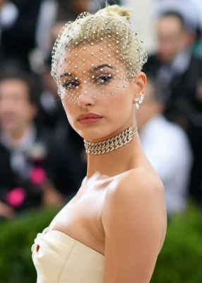 Hailey Baldwin. As if immortalised in an Irving Penn photograph, the actress's matte skin was accented with a rose blush lip lacquer. The work of makeup artist Robert Sesnek, on behalf of Laura Mercier, Baldwin's eyes sparkled just as much as her diamond veil thanks to the use of Laura Mercier Caviar Stick Eye Colour.