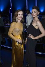 Red-headed beauty Isabelle Huppert attends Chopard's Space Party in a rich mustard coloured Nina Ricci ensemble, while Clotilde Courau dons all black.