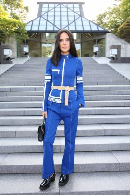 Jennifer Connelly channelled an athleisure vibe, breaking up the blue of her sports-style suit with a nude belt. A sleek hairstyle and natural makeup softened the look.