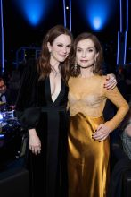 Julianne Moore's Alexander McQueen dress looks understated yet spectacular, while Isabelle Huppert dons a vintage-inspired look.