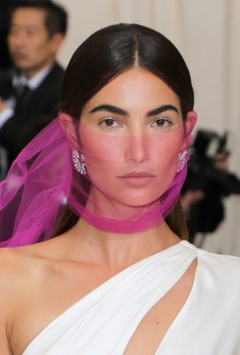 Lily Aldridge. The magenta netting didn't hide this star's glowing skin or, better yet, her statement brows. The actress ensured her dewy skin and matte peach lips were perfectly prepped by make up artist Quinn Murphy, who utilised Armani Beauty products before tying the veil.