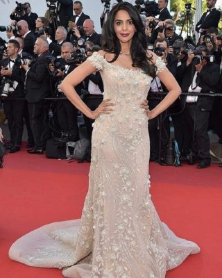 Mallika Sherawat | An ultra-feminine barely-there pink, off-the-shoulder mermaid silhouette dress crafted from exquisite silk tulle by Georges Hobeika boasts mini-pearls, soft-coloured crystals and floral motifs.