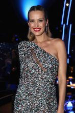 Petra Nemcova wears her tresses up to showcase statement amethyst earrings and a one-shouldered multi-coloured sequined Elie Saab gown.