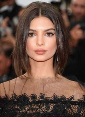 Emily Ratajkowski paired a nude lip with a bronze contour and a smokey eye for an understated, natural glow.
