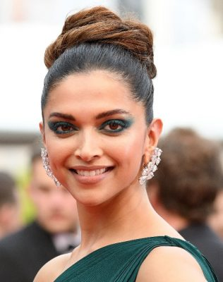 Deepika Padukone matched her eyes to her gown with a deep green shadow smudged into a messy cat's eye.