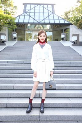 Chinese actress Tan Yang layered a turtle neck sweater under a pleated shirtdress.