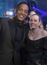 Actor Will Smith poses for a picture with Chopard's co-president Caroline Scheufele in a strikingly handsome jet-black tailored suit.