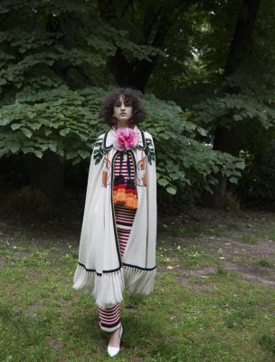 Top, trousers, cape and brooch, GUCCI   shoes, MAX MARA   earrings, MARNI