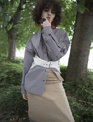 Shirt, skirt and belt, BALENCIAGA   earrings, MARNI   rings, VERNISSAGE ILENIA CORTI