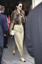 Kendall Jenner's Seventies-style round sunglasses channel John Lennon.