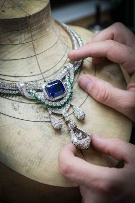 Making of the decadent Pegase Necklace, complete with emeralds, diamonds, sapphires, and a Sri Lankan emerald-cut sapphire weighing 45.10 carats. Comes with a detachable clip.