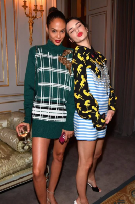Joan Smalls & Kendall Jenner. The models wore Miu Miu looks to the designer's after party and channelled the triumphant return of the vibrant red lip. While each had a varying colour tone, the simple eye makeup and hairstyles also signal a return to the use of targeting a specific area across the face with beauty products, for instance, either the brow, the lip or the lashes. For a bold statement try Pat McGrath's gold 002 pigment eye shadow.