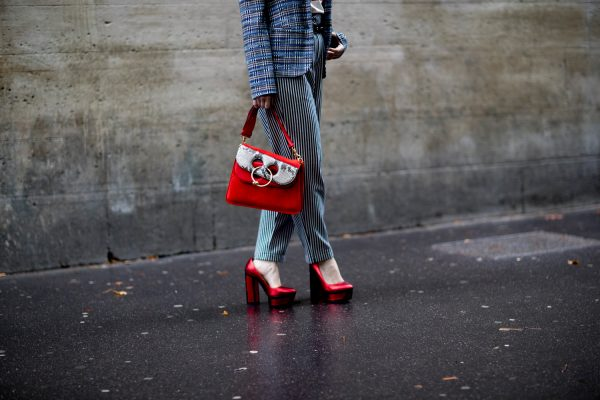 Metallic ruby red pumps and J.W. Anderson's Pierce handbag have an uplifting effect on muted stripes and checks.