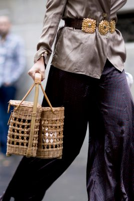 A wicker basket is an unexpected, yet welcome accessory that lends a summery vibe to any ensemble.