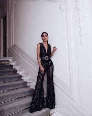 Camila Coelho attends a dinner with Elie Saab in a jumpsuit by the Lebanese designer.