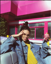 Little method is involved with model Kendall Jenner's fly away version apart from the pink hair tie which offers a pinch of panache. Burger, glasses and pink background optional.