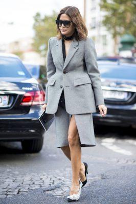 Miroslava Duma makes day wear an art form by pairing a peplum-structured suit with diamanté encrusted Balenciaga kitten heels.