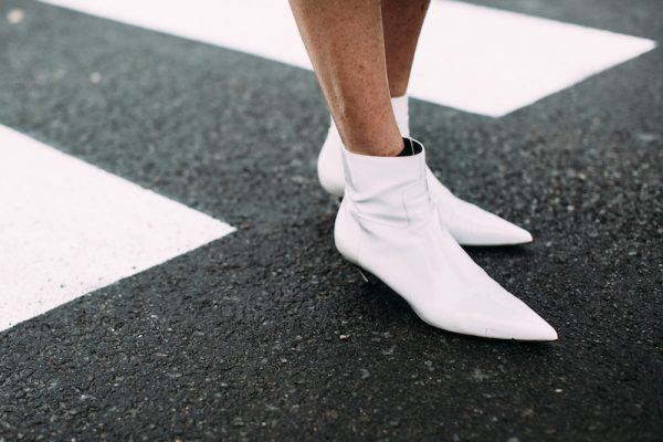 Be brave. A stark white ankle bootie with a kitten heel is all about embracing the future of design. Pair with slim pencil skirts or evening frocks