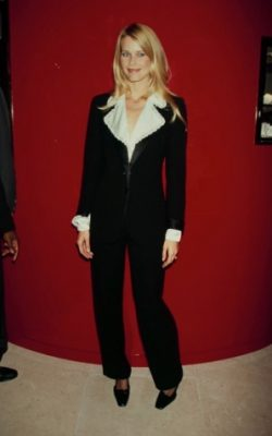 1995: Looking plush and comfy in a velvet-tailored suit. An oversized collar and cinched-in waist adds an ultra-feminine feel to this otherwise masculine style.