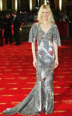 2004: This splendid Alexander McQueen floor-length metallic gown highlights Schiffer's womanly figure, while shimmering silver accents her pale complexion and fair hair.