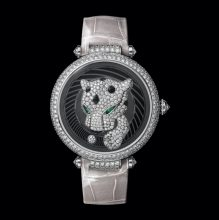Cartier's Panthère Joueuse showcases a playful panther with an outreached paw that follows a diamond-set ball around the dial. The ball indicates the hours, and the paw, the minutes. Set with 254 brilliant-cut diamonds and complete with lacquer spots and emerald eyes.