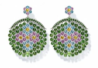 Oversized and perfectly rounded earrings featuring a moss-green hue complete Chopard's latest addition to the brand's Red Carpet Collection, which is announced each year in collaboration with Cannes Film Festival.
