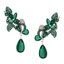 Elegant and majestic, Faberge's deep emerald foliage earrings are fit for any royal occasion. These splendid creations should be on display, so be sure to wear your hair up for a bold impact.