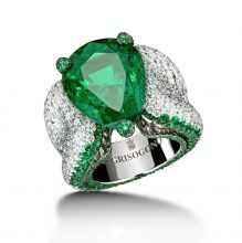 A spectacular luxury creation by De Grisogono, this statement ring features a staggeringly-big showcase emerald, whose shine is emphasised by a thick band mottled with diamonds.