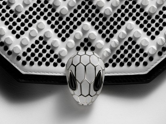 """""""The studs were made to look like the reverse side of a diamond, rather than a normal pointy stud and the chevron pattern is something I use quite often, but in black and white it almost looks like the scales on a snake, which I thought was very fitting for the project."""""""