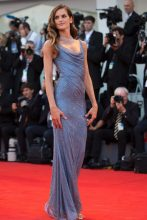 Model Izabel Goulart arrives on the red carpet of the premiere of the film Downsizing wearing a denim Alberta Ferretti dress embellished with Swarovski crystals