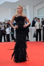 Renata Kuerten wears black gown with feathers by Alberta Ferretti at the opening ceremony of the 74th Venice Film Festiva