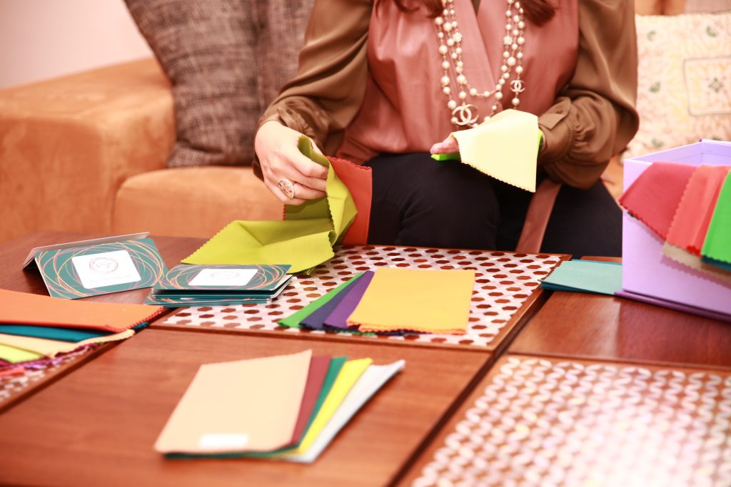 Fatima Al Shirawi browses her colour swatches from The Gracious F