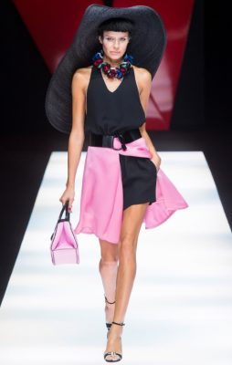 Giorgio Armani: Giorgio Armani worked with a spectrum of neon hues this season cleverly subduing by mixing them into black garments and ensembles. Shots of pink, blue, red and green had impact but weren't overwhelming thanks to the black trousers and skirts they were sent out with.