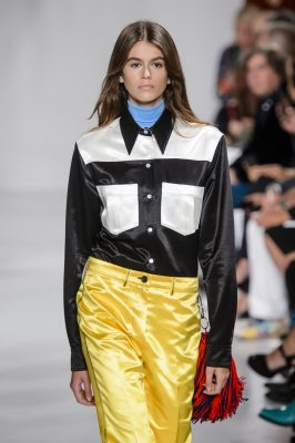 Calvin Klein: Kaia Gerber's star continued to rise with her catwalk debut at Calvin Klein. Building on his promising start last season, Raf Simons extended his creative narrative into Warhol prints, fringing, bright block colours and high-shine separates.