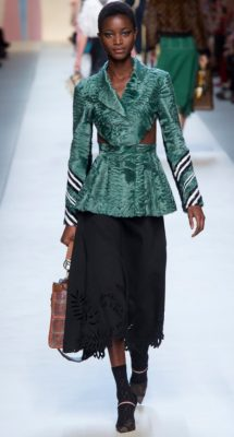 Fendi:  Triangulation threaded its way through Karl Lagerfeld and Silvia Venturini Fendi's collection where flared skirts, structured shoulders and angular stripes all echoed the shape.