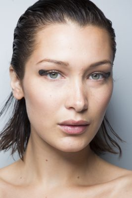 Jason Wu: Slicked back wet-look hair and a blunt cat's eye proved to be simple yet effective at Jason Wu.