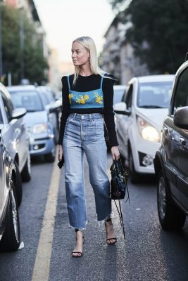 Summer's crop tops are given a new lease on life, layered over a long-sleeve shirt and paired with your favourite denim jeans