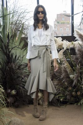 Nicole Miller: Designer Nicole Miller chose to reinvent safari chic by imagining society It Girls in the tropics. Aside from a dose of khaki, Miller paired black belted jackets with city shorts and trompe l'ceil prints with hand drawn parrots and butterflies.