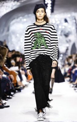 The Motif | Everyone loves a slogan tee, especially at the moment thanks to the likes of Gucci. Maria Grazia Chiuri has got on board, swapping last season's 'We Should All Be Feminists' print shirt for a less political, more fun, emerald-green chameleon.