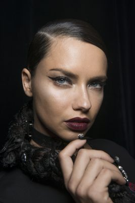 Phillip Plein: Black nails, vampy red-stained lips and architectural graphic eyeliner conjured up visions of seductive, modern day femme fatales at Phillip Plein.